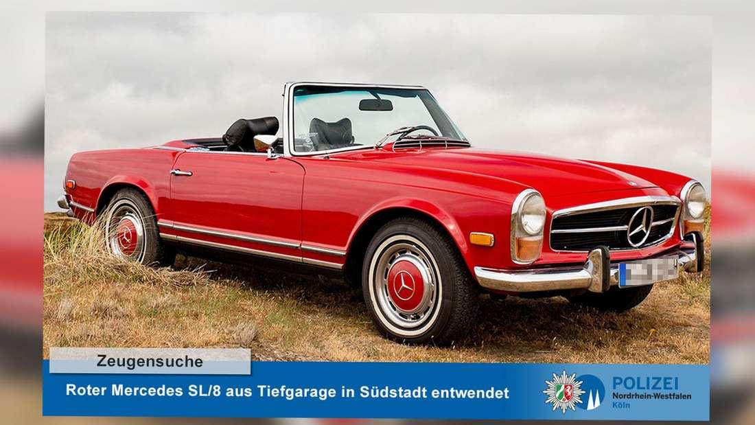 """Ein roter Mercedes 280 SL/8 auf einer Wiese. Auf einer Bauchbinde steht: """"Zeugensuche. Roter Mercedes SL/8 aus Tiefgarage in Südstadt entwendet."""