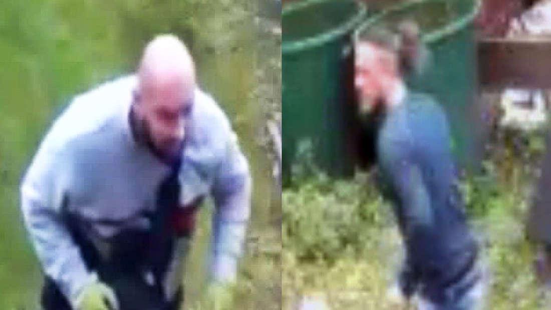 Zwei Männer, Einbrecher laufen durch einen Garten.