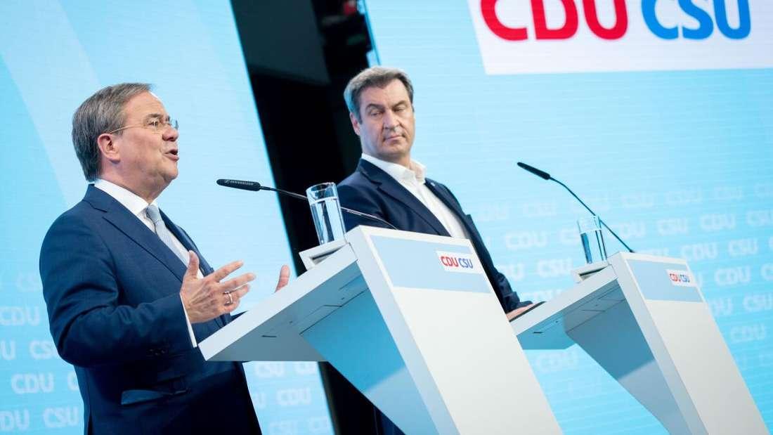 Armin Laschet (li.), Unions-Kanzlerkandidat, und Markus Söder, CSU-Chef, geben eine Pressekonferenz zum gemeinsamen Wahlprogramm für die Bundestagswahl.