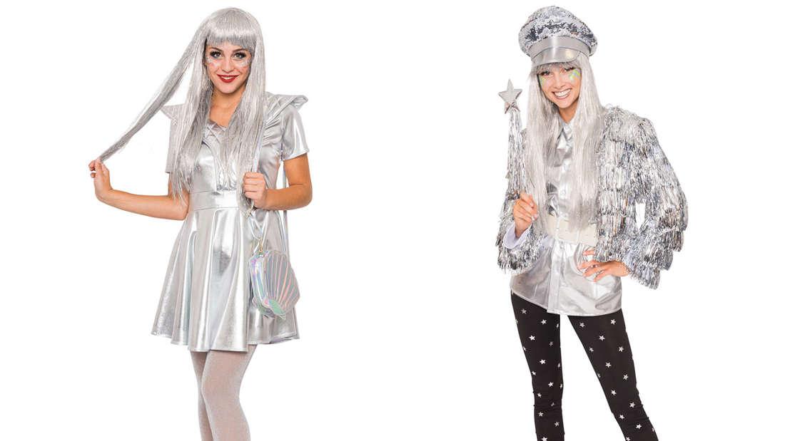 Zwei Frauen mit metallischen Karnevalskostümen.